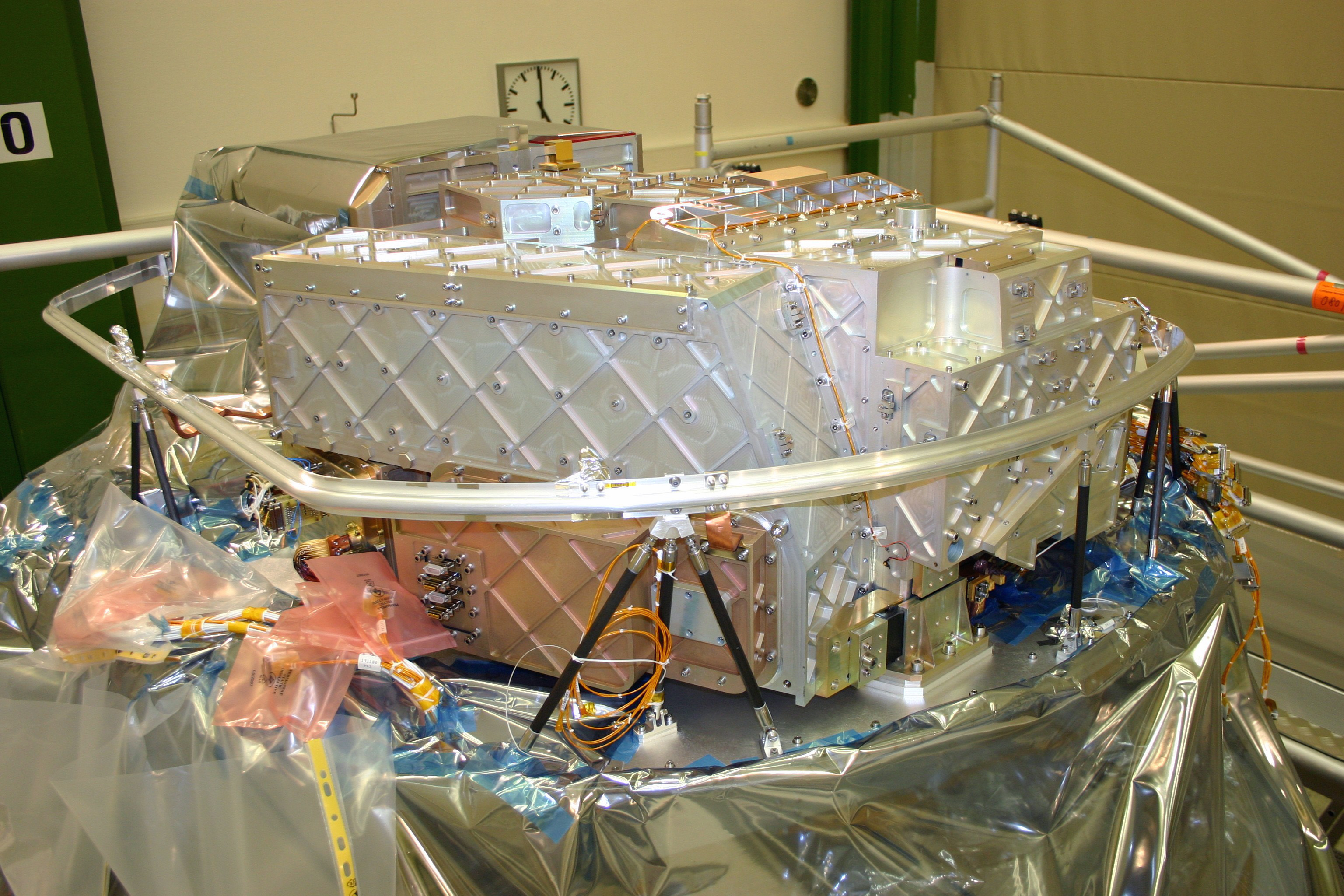 PACS FM FPU mounted on the Herschel flight cryostat optical bench in Astrium, Friedrichshafen, Germany.
