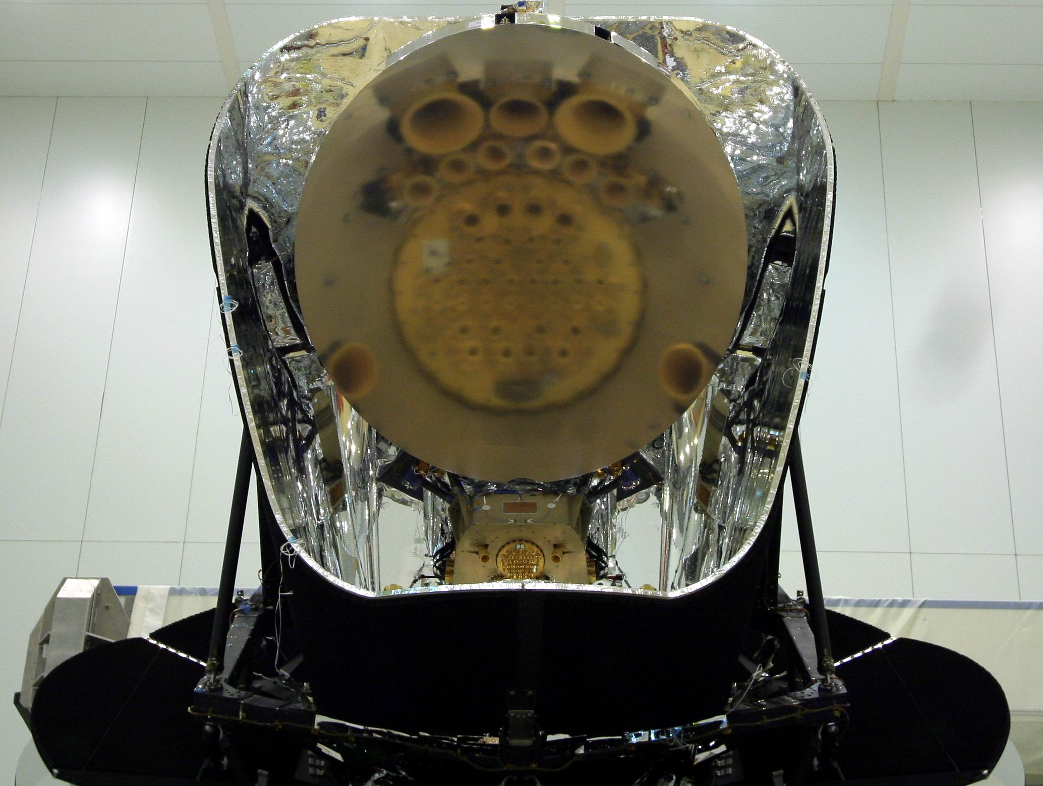 Planck Focal Plane Unit reflected in its primary mirror