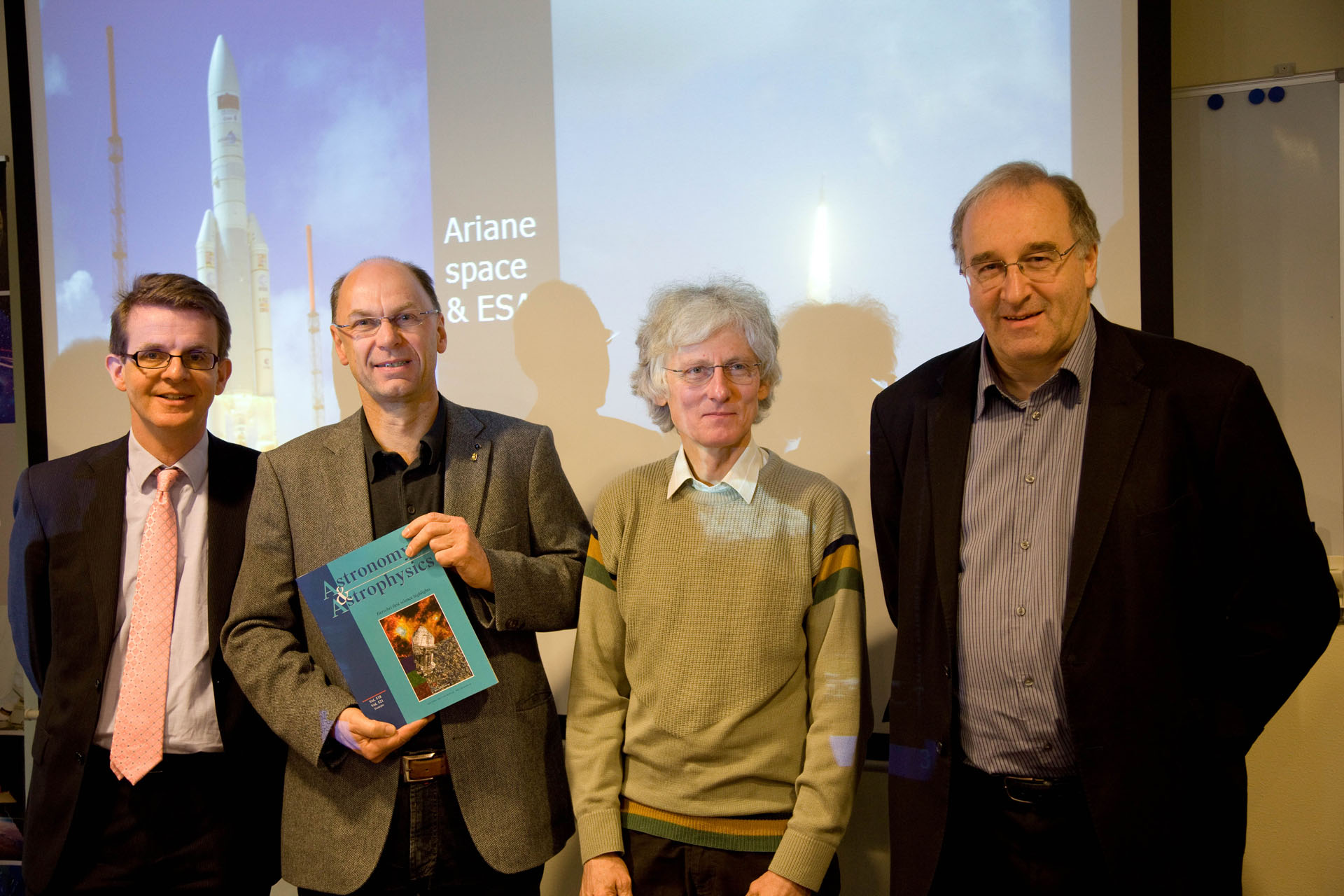 Frank Helmich, Göran Pilbratt, Albrecht Poglitsch, and Matt Griffin posing with one of the very first Herschel A&A special issue delivered to SRON Utrecht